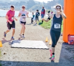 Jennifer Wyman, Brooke Burns, Matthew Garibaldi finish line
